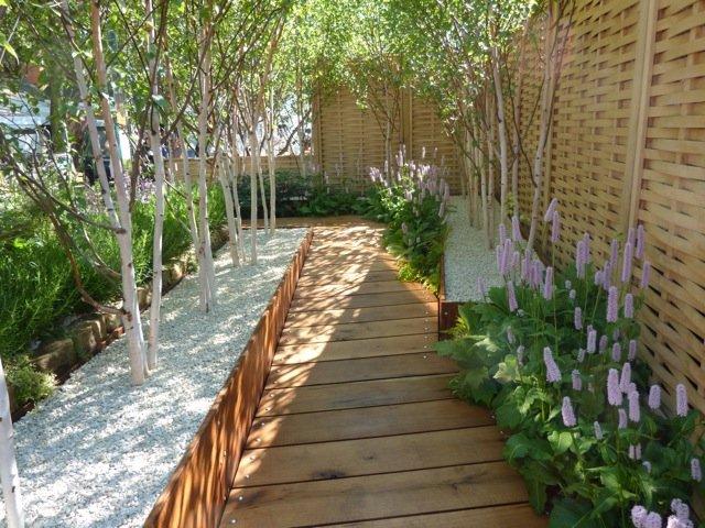 Jardines modernos 60 fotos e ideas de dise o de patios for Paredes de madera para jardin