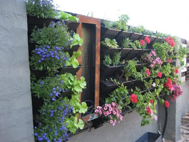 Jardines verticales de 40 fotos de inspiraci n verde - Macetas para jardin vertical ...
